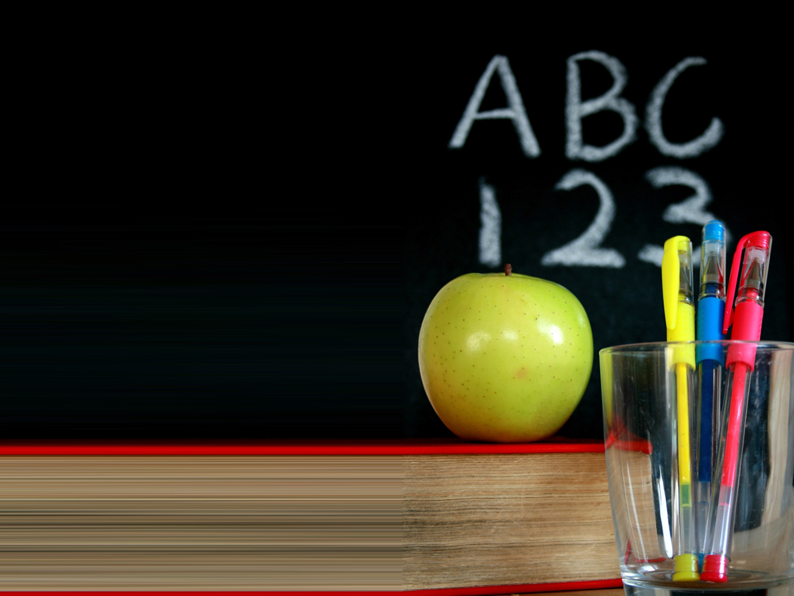 Chalkboard with a green apple and pens PPT Backgrounds