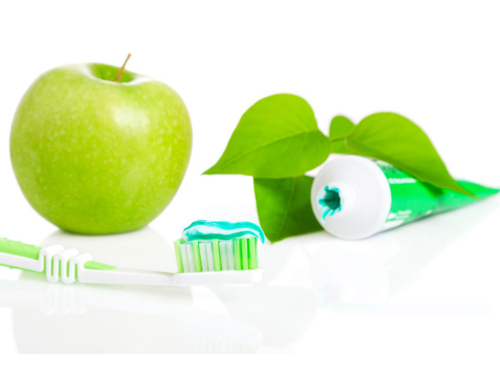 Macro toothbrush with dental paste PPT Backgrounds